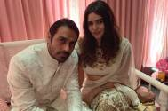 Arjun Rampal and Gabriella Demetriades twin in white